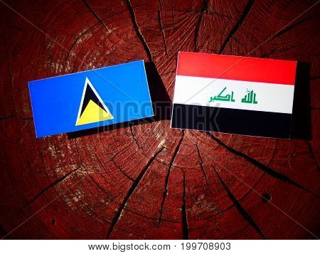 Saint Lucia Flag With Iraqi Flag On A Tree Stump Isolated