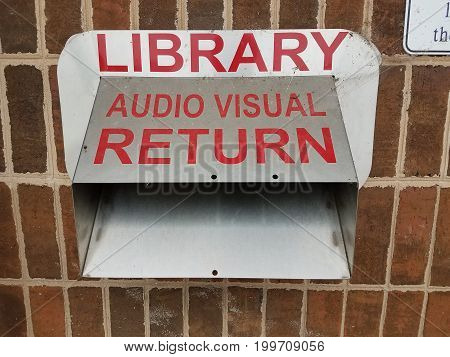 metal library audio visual sign and return chute