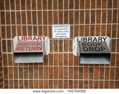 metal library book and audio visual return chutes and signs