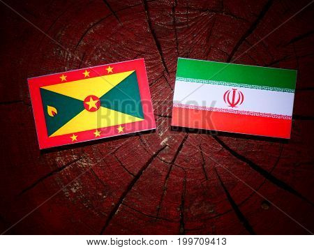 Grenada Flag With Iranian Flag On A Tree Stump Isolated