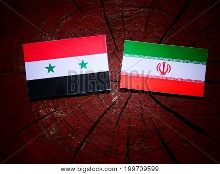 Syrian Flag With Iranian Flag On A Tree Stump Isolated