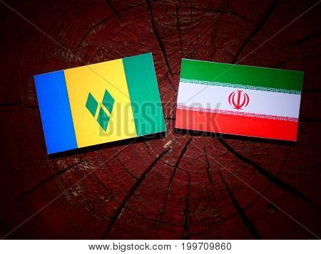 Saint Vincent And The Grenadines Flag With Iranian Flag On A Tree Stump Isolated