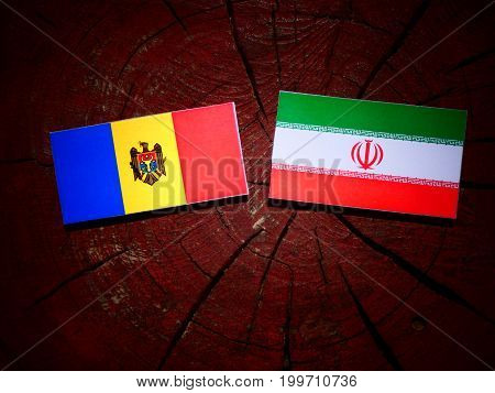 Moldovan Flag With Iranian Flag On A Tree Stump Isolated