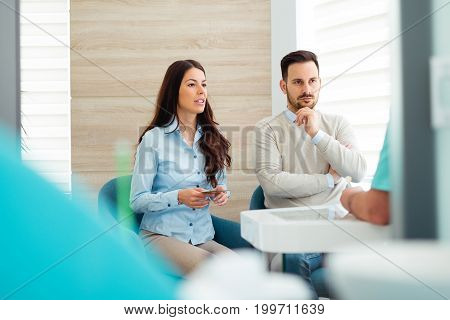 Patients consulting the dentist at dental clinic