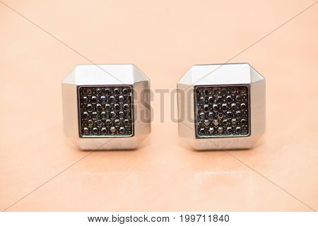 Wedding ceremony accessories details. Black cuff-links isolated