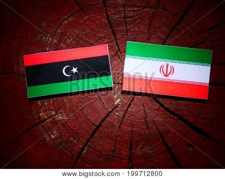 Libyan Flag With Iranian Flag On A Tree Stump Isolated