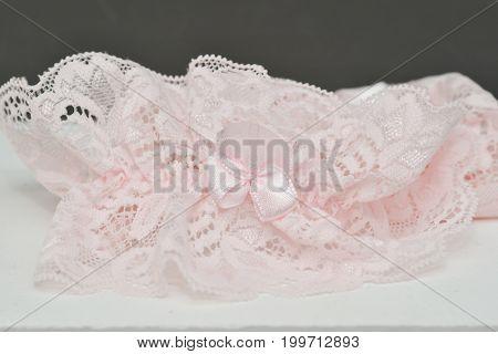 wedding accessories details. bride pink garter isolated