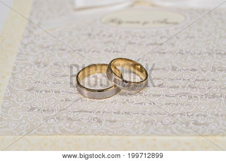 gold wedding rings isolated on a piece of paper