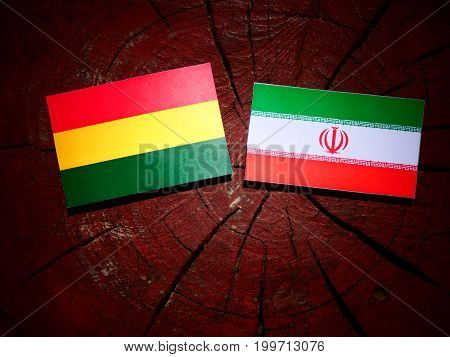 Bolivian Flag With Iranian Flag On A Tree Stump Isolated