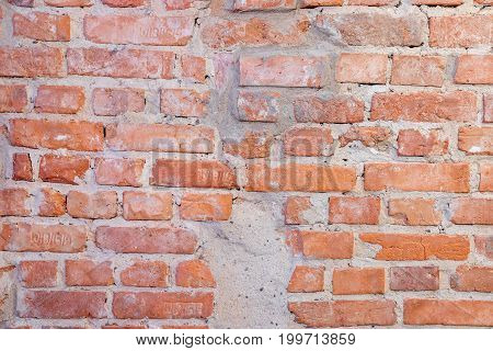 Red old stonewall background of red bricks