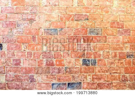 old stonewall background, red bricks, dirty texture
