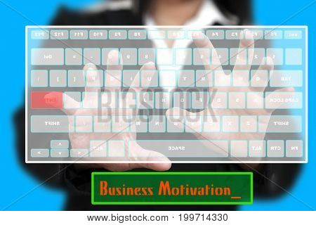 Business Woman typing Business Motivation on Virtual Keyboard  (selctive focus at Hand)