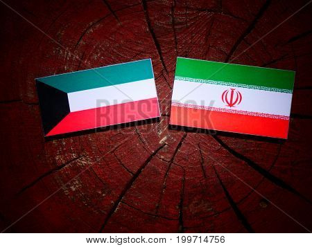 Kuwaiti Flag With Iranian Flag On A Tree Stump Isolated