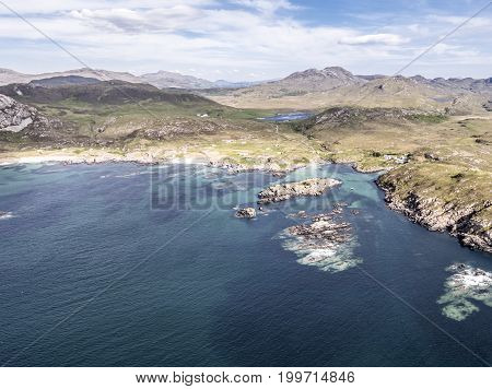 Stunning aerial shot of Ardnamurchan Point, Great Britains most westerly point, with the beautiful white beaches and costline in the background, Scotland