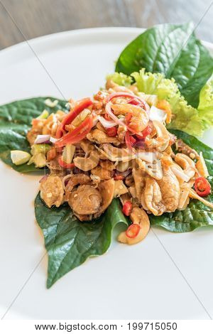 Crispy fish maw and dried shrimp in spicy salad