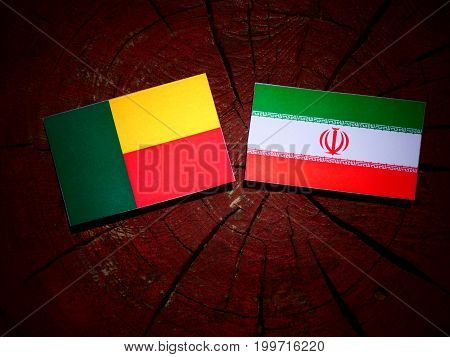 Benin Flag With Iranian Flag On A Tree Stump Isolated