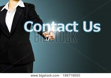 business woman touching Contact us word on blue background