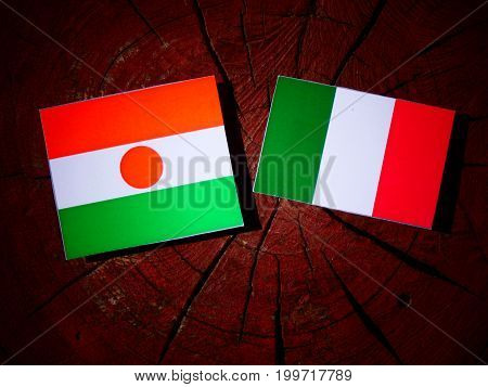 Niger Flag With Italian Flag On A Tree Stump Isolated