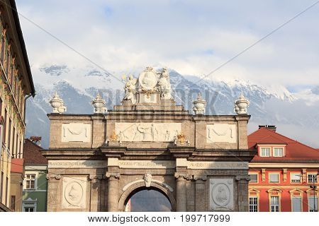 Triumphal Arch (Triumphpforte) and snow mountains in Innsbruck Austria