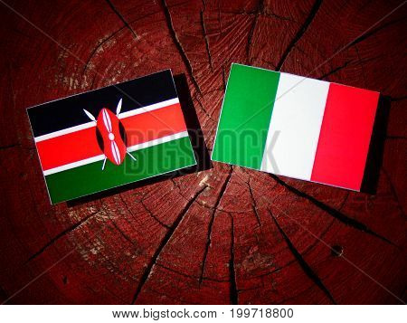 Kenyan Flag With Italian Flag On A Tree Stump Isolated