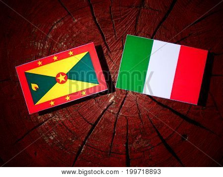Grenada Flag With Italian Flag On A Tree Stump Isolated
