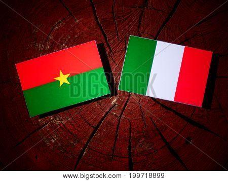 Burkina Faso Flag With Italian Flag On A Tree Stump Isolated