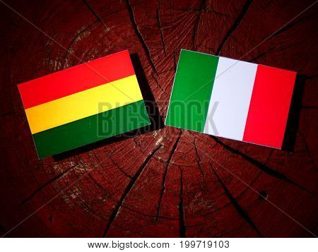 Bolivian Flag With Italian Flag On A Tree Stump Isolated