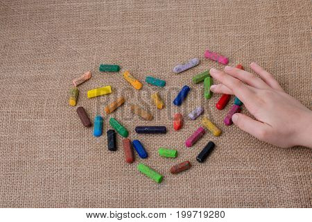 Colorful Crayons Form A Heart Shape