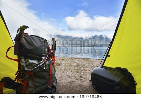 Tourists Backpack In The Tent With Segara Anak Lake View