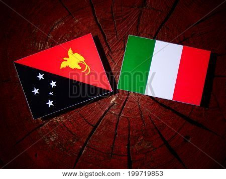 Papua New Guinea Flag With Italian Flag On A Tree Stump Isolated