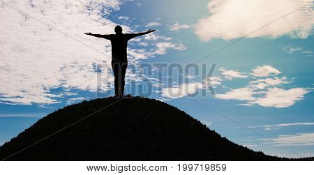 silhouette man open arms standing alone on hill