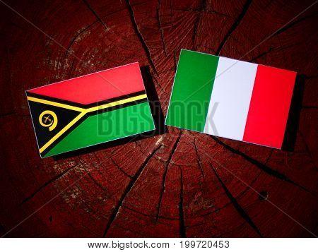 Vanuatu Flag With Italian Flag On A Tree Stump Isolated