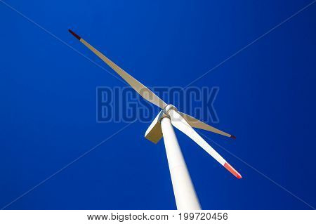 Windmills for the production of electrical energy close-up ecology conservation of nature