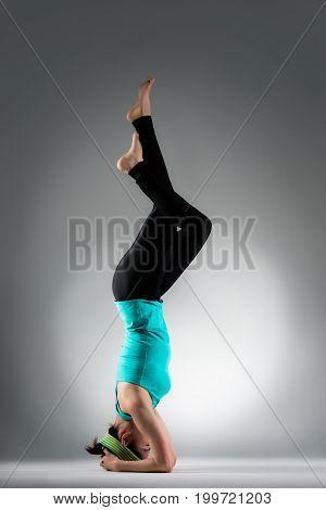 Beautiful Yoga Teacher Making Fitness Posture