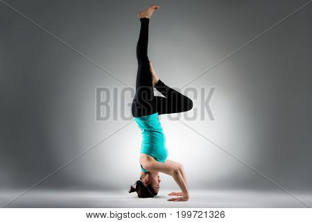 Female Yoga Fitness Coach Making Difficult Posing