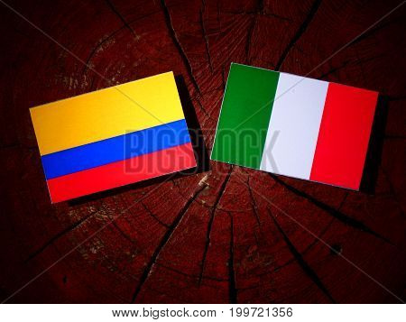 Colombian Flag With Italian Flag On A Tree Stump Isolated