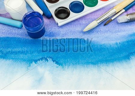 Aquarelle Palette With Paintbrushes On Blue Watercolor Hand Painted Background