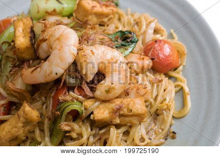 Mie Goreng, Fried Yellow Noodle. With Prawn Seafood Vegetable Tomato Choy Egg Garlic Shallot Onion S