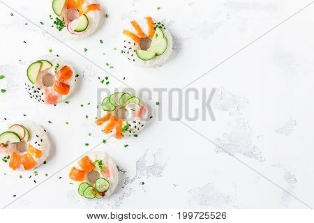 Sushi donuts set on white background. Sushi food trend. Flat lay top view copy space