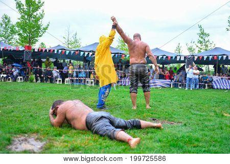 successful oil wrestling champion & win concept