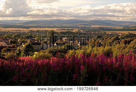City in the valley .. Forfar, Scotland - July 31, 2017 View from the hill to the scenic landscape above the town of Forfar in Scotland.