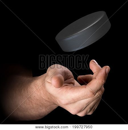 Hand Tossing Hockey Puck