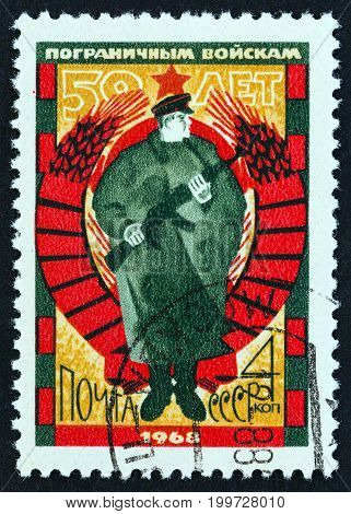 USSR - CIRCA 1968: A stamp printed in USSR issued for the 50th anniversary of Soviet Frontier Guards shows Frontier Guard, circa 1968.