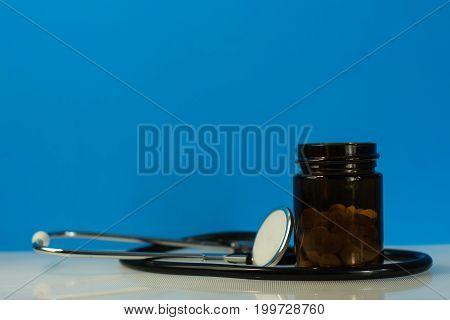 Bottle for pills. Beautiful blue background. Medcine