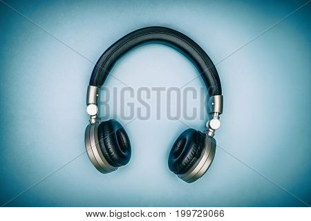 Metallic golden headphone on blue vintage color