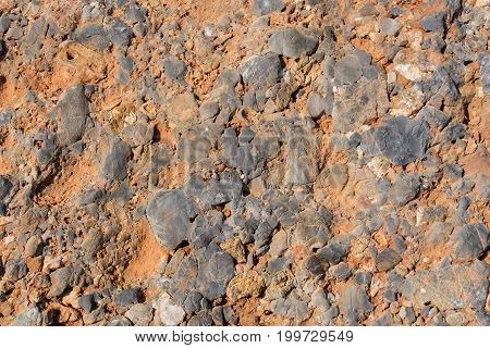 View on a colorful Rock. Close-up of a Rock Object. Natural Stone Texture