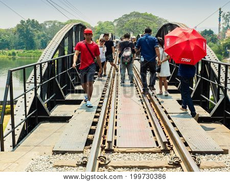 Kanchanaburi Thailand- March 04 2017: Tourists are visiting the historic bridge on the river Kwai which was built by the Allied prisoners of war under the captivity of Japanese army during the World War II.