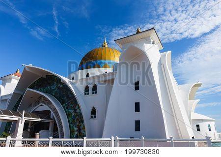 Melaka floating mosque or Masjid Selat Melaka in Melaka or Malacca Malaysia with blue sky