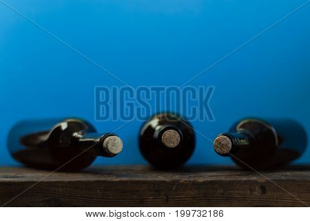 Bottle with red wine on a beautiful white wood background