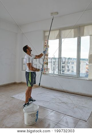 Indian Worker Painting Walls
